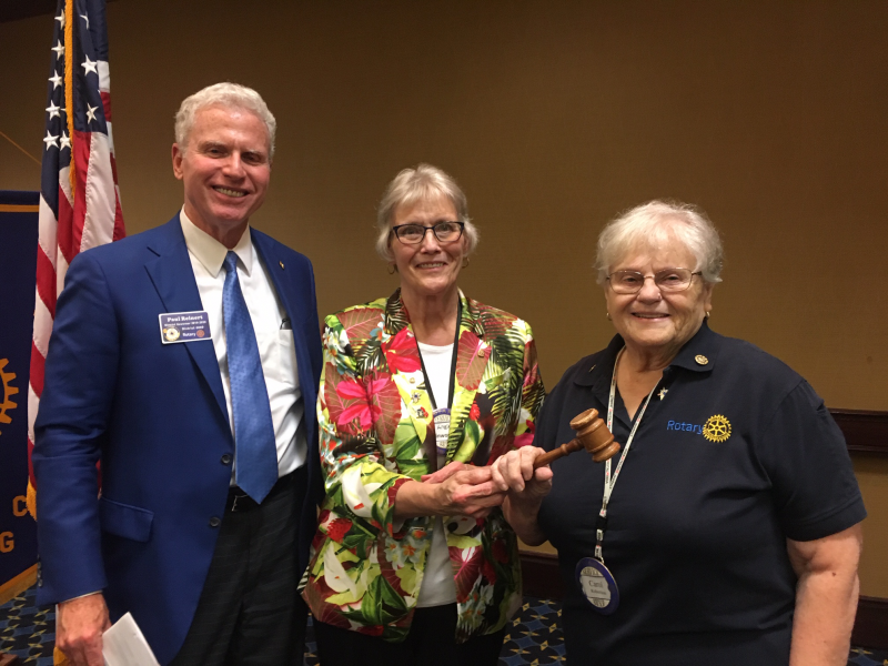 Passing the gavel DG Paul Reinert, IPP Angie Kinworthy, and President Carol Robertson